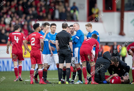 Rangers captain Kenny Miller leads the  protests to referee William Collum after he showed a straight red card to Ryan Jack of Rangers for a challenge on Stevie May of Aberdeen