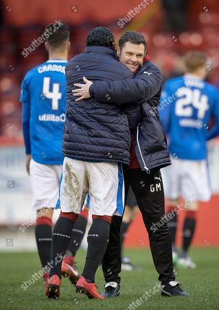 Rangers interim manager Graeme Murty celebrates with Carlos Pena of Rangers after winning 2-1