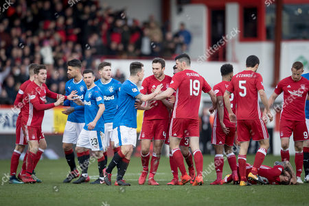 Ryan Jack of Rangers clashes with Andrew Considine of Aberdeen after he was shown a red card by referee William Collum for a rash challenge on Stevie May of Aberdeen