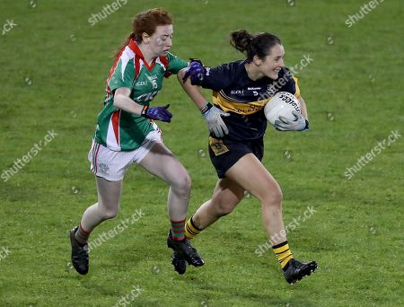 Stock Image of Carnacon vs Mourneabbey. Carnacon?s Emma Cosgrave with Roisin O?Sullivan of Mourneabbey