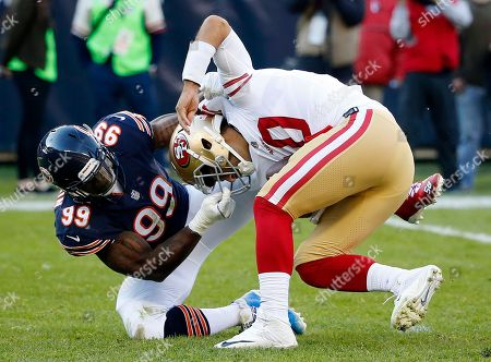 Lamarr Houston, Jimmy Garoppolo. Chicago Bears linebacker Lamarr Houston (99) sacks San Francisco 49ers quarterback Jimmy Garoppolo (10) during the first half of an NFL football game, in Chicago