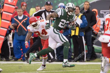 , 2017, New York Jets running back Matt Forte (22) runs past Kansas City Chiefs cornerback Darrelle Revis (24) during the NFL game between the Kansas City Chiefs and the New York Jets at MetLife Stadium in East Rutherford, New Jersey. The New York Jets won 38-31