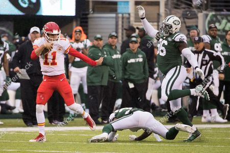 , 2017, Kansas City Chiefs quarterback Alex Smith (11) runs with the ball as he gets past New York Jets safety Jamal Adams (33) and defensive end Muhammad Wilkerson (96) during the NFL game between the Kansas City Chiefs and the New York Jets at MetLife Stadium in East Rutherford, New Jersey