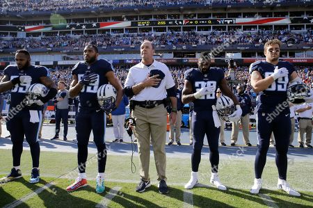 Mike Mularkey, Jurrell Casey, Wesley Woodyard, DeMarco Murray, Wesley Woodyard. Tennessee Titans head coach Mike Mularkey, center, stands with Jurrell Casey (99), Wesley Woodyard (59), DeMarco Murray (29) and Wesley Woodyard (59) for the national anthem before an NFL football game against the Houston Texans, in Nashville, Tenn