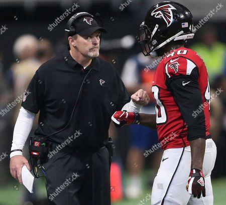 Atlanta Falcons head coach Dan Quinn speaks with Atlanta Falcons fullback Derrick Coleman (40) during the first half of an NFL football game between the Atlanta Falcons and the Minnesota Vikings, in Atlanta