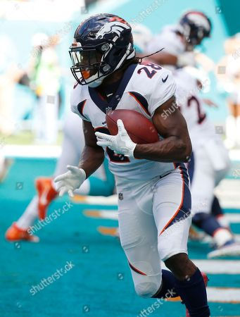 Denver Broncos running back Jamaal Charles (28) runs with the ball, during the first half of an NFL football game against the Miami Dolphins, in Miami Gardens, Fla