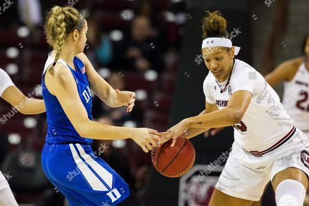 South Carolina forward Alexis Jennings (35) steals the ball from Duke guard/forward Faith Suggs (14) in the NCAA Womens Basketball matchup at Colonial Life Arena in Columbia, SC