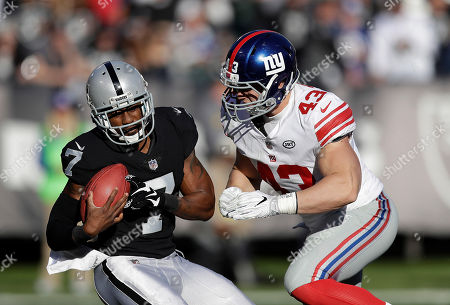 Shane Smith, Marquette King. New York Giants' Shane Smith (43) tackles Oakland Raiders punter Marquette King (7) during the first half of an NFL football game in Oakland, Calif