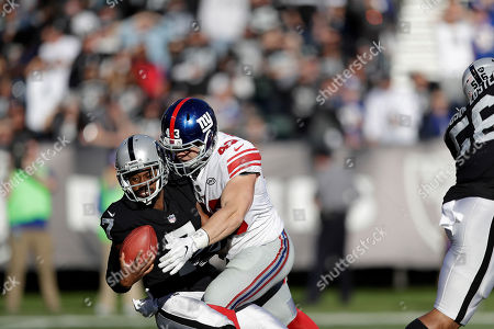 Marquette King, Shane Smith. New York Giants' Shane Smith (43) tackles Oakland Raiders punter Marquette King (7) during the first half of an NFL football game in Oakland, Calif