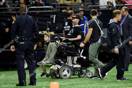 Stock Photo of Former Saints player Steve Gleason is on the sideline before an NFL football game against the Carolina Panthers in New Orleans