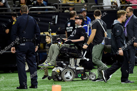 Former Saints player Steve Gleason is on the sideline before an NFL football game against the Carolina Panthers in New Orleans