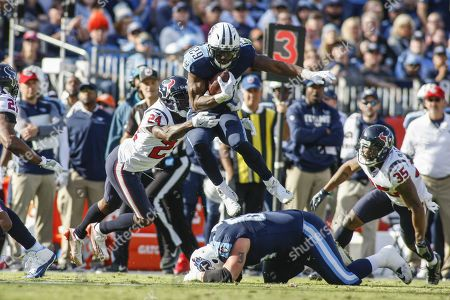 Tennessee Titans running back DeMarco Murray, 29, leaps over other players as he runs against the Houston Texans in the first half of their NFL game at Nissan Stadium in Nashville, Tennessee, USA, 03 December 2017. Titans won the 24-13.