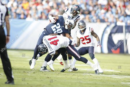 Tennessee Titans running back DeMarco Murray, 29,  is tackled by Houston Texans inside linebacker Zach Cunningham, 41,and Houston Texans inside linebacker Benardrick McKinney, 55,  during the second half of their NFL game at Nissan Stadium in Nashville, Tennessee, USA, 3 December 2017. Titans won the 24-13.