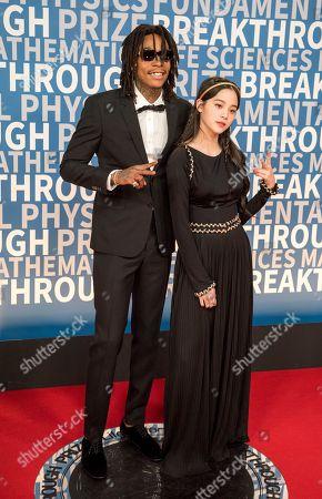 Wiz Khalifa, Ouyang Nana. Wiz Khalifa poses with Ouyang Nana at the 6th annual Breakthrough Prize Ceremony at the NASA Ames Research Center, in Mountain View, Calif