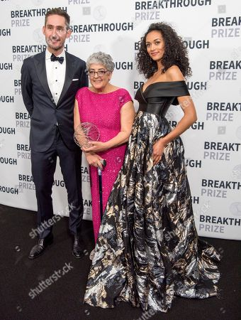 Instagram co-founder and CEO Kevin Systrom, left, and Miss USA Kara McCullough, right, congratulate 2018 Breakthrough Prizes in Life Sciences winner Joanne Chory backstage at the 6th annual Breakthrough Prize Ceremony at the NASA Ames Research Center, in Mountain View, Calif