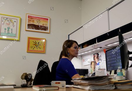 Univision news anchor Maria Elena Salinas sits works in her office in Doral, Fla. Salinas is leaving Univision News after more than 35 years, a decision greeted with sadness by many immigrants who see her and co-anchor Jorge Ramos as a lifeline in hostile times