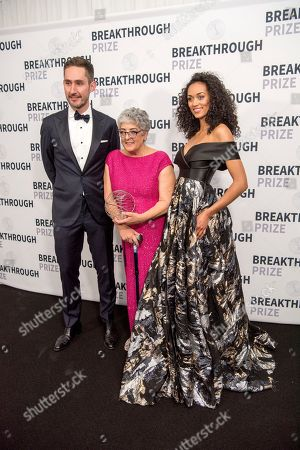 Instagram co-founder and CEO Kevin Systrom, left, and Miss USA Kara McCullough, right, congratulate 2018 Breakthrough Prizes in Life Sciences winner Joanne Chory backstage at the 6th annual Breakthrough Prize Ceremony at the NASA Ames Research Center on in Mountain View, California