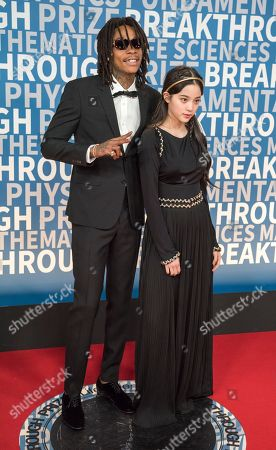 Stock Photo of Wiz Khalifa, Ouyang Nana. Wiz Khalifa poses with Ouyang Nana at the 6th annual Breakthrough Prize Ceremony at the NASA Ames Research Center on in Mountain View, California