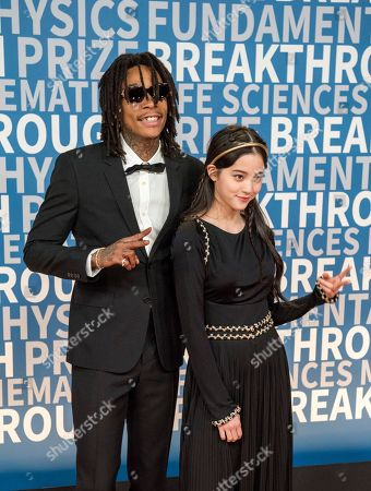 Wiz Khalifa, Ouyang Nana. Wiz Khalifa poses with Ouyang Nana at the 6th annual Breakthrough Prize Ceremony at the NASA Ames Research Center on in Mountain View, California