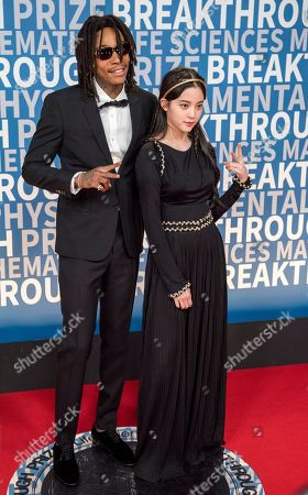 Stock Image of Wiz Khalifa, Ouyang Nana. Wiz Khalifa poses with Ouyang Nana at the 6th annual Breakthrough Prize Ceremony at the NASA Ames Research Center on in Mountain View, California