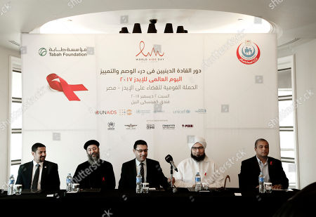 Ahmed Khamis, Boulos Soror, Walid Kamal, Ali al-Jifri, Mohammed Shahi. From left to right UNAIDS country manager Ahmed Khamis, Christian father Boulos Soror, Dr. Walid Kamal, Islamic scholar and Sheik Ali al-Jifri, and Tabah Foundation member Mohammed Shahin, prepare for an even part of the World AIDS Day 2017 national advocacy campaign at a hotel, in Cairo, Egypt. An alarming HIV epidemic is silently spreading in Egypt, with an annual growth of up to 40 percent and funds to deal with the crisis running out by next year, U.N. officials and activists say