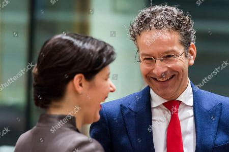 The Chair of the Eurogroup Jeroen Dijsselbloem, right, talks with Latvia's Finance Minister Dana Reizniece-Ozola prior to a meeting of eurozone finance ministers at the Europa building in Brussels on . Eurozone finance ministers meet Monday to elect a new president for the club of 19 nations that share the euro currency