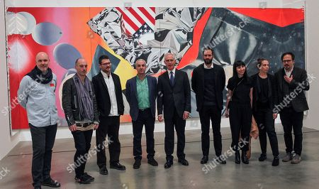 Stock Image of Guggenheim Bilbao Museum's Director, Juan Ignacio Vidarte (C), poses for photographers with several artists, who takes part in the exhibition 'Art and Space' including Spaniard Prudencio Irazabal (4-L) and Mexican Damian Ortega (R), at Guggenheim Bilbao Museum, in Bilbao, Basque Country, northern Spain, 04 December 2017. The exhibition, running from 05 December 2017 to 15 April 2018, is focused on the collaboration between Basque artist Eduardo Chillida and German philosopher Martin Heidegger in 1969.