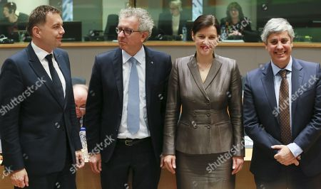 The four candidates for the Presidency of the Eurogroup (L-R) Slovak Finance Minister Peter Kazimir, Luxembourg's Finance Minister Pierre Gramegna, Latvian Finance Minister Dana Reizniece-Ozol and Portuguese Finance Minister Mario Centeno