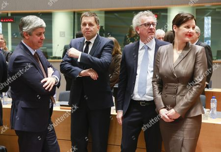 The four candidates for the Presidency of the Eurogroup with (L-R) Portuguese Finance Minister Mario Centeno, Slovak Finance Minister Peter Kazimir, Luxembourg's Finance Minister Pierre Gramegna and Latvian Finance Minister Dana Reizniece-Ozola wait for the start of an Eurogroup meeting.