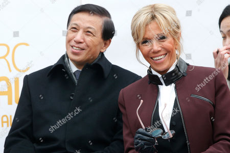"""French First lady Brigitte Macron and Chinese vice-foreign minister Zhang Yesui attend a naming ceremony of the panda born at the Beauval Zoo in Saint-Aignan-sur-Cher, France, . The 4-month-old cub is called Yuan Meng, which means """"the realization of a wish"""" or """"accomplishment of a dream"""