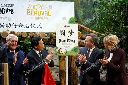 """French First lady Brigitte Macron, French Junior Minister for Foreign Affairs Jean-Baptiste Lemoyne, right, Chinese vice-foreign minister Zhang Yesui, 2nd left, and French former prime minister Jean-Pierre Raffarin, left, attend a naming ceremony of the panda born at the Beauval Zoo in Saint-Aignan-sur-Cher, France, . The 4-month-old cub is called Yuan Meng, which means """"the realization of a wish"""" or """"accomplishment of a dream"""