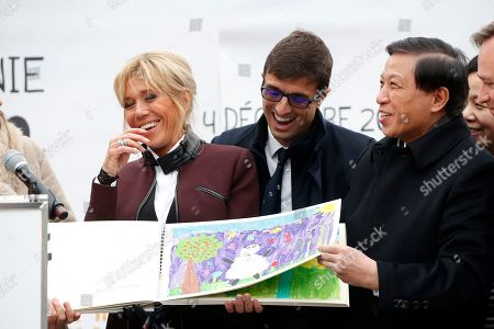 """French First lady Brigitte Macron shares a laugh with Chinese vice-foreign minister Zhang Yesui, right, and Beauval Zoo director Rodolphe Delord during a naming ceremony of the panda born at the Beauval Zoo in Saint-Aignan-sur-Cher, France, . The 4-month-old cub is called Yuan Meng, which means """"the realization of a wish"""" or """"accomplishment of a dream"""
