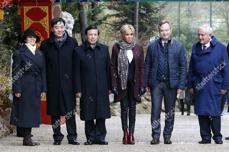 French First lady Brigitte Macron (C) French Junior Minister for Foreign Affairs Jean-Baptiste Lemoyne (2-R), Chinese vice-foreign minister Zhang Yesui (3-L) and former French Prime Minister Jean-Pierre Raffarin (R) pose as they arrive to attend  a naming ceremony of the newborn baby panda 'Yuan Meng' in Saint-Aignan-sur-Cher, central France, 04 December 2017. As France's 'First Lady', Brigitte Macron shares godmother duties with the wife of the Chinese president.