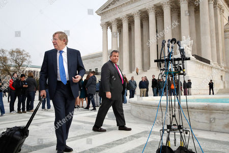 Stock Picture of Chris Christie, Theodore Olson. Theodore Olson, left, the lawyer for New Jersey, walks with New Jersey Gov. Chris Christie to attend a news conference after leaving the Supreme Court where a case on sports betting is being heard
