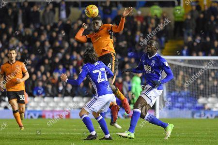 Wolverhampton Wanderers midfielder Alfred N'Diaye (4) wins a header 0-1 during the EFL Sky Bet Championship match between Birmingham City and Wolverhampton Wanderers at St Andrews, Birmingham