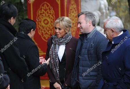 French President wife's Brigitte Trogneux (C) flanked by French Junior Minister for Foreign Affairs Jean-Baptiste Lemoyne and former senator Jean-Pierre Raffarin meets China's Vice Foreign Minister Zhang Yesui (L) before the panda cub's name ceremony.