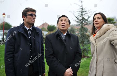 Director of the zoo, Rodolphe Delord, China's Vice Foreign Minister Zhang Yesui and Communication director Delphine Delord arrive for the panda cub's name ceremony.