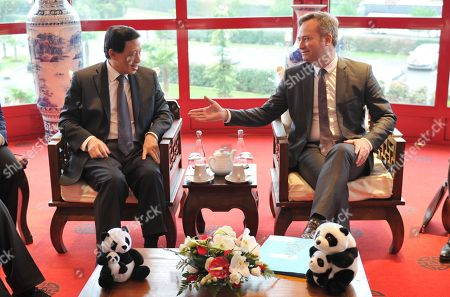 China's Vice Foreign Minister Zhang Yesui (L) and French Junior Minister for Foreign Affairs Jean-Baptiste Lemoyne (R) are waiting for the panda cub's name ceremony.