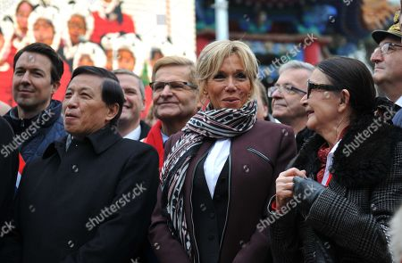 """China's Vice Foreign Minister Zhang Yesui, French President wife's Brigitte Trogneux and founder of the zoo Francoise Delord are pictured as they inaugurate the name of the panda cub """"Yuan Meng""""."""