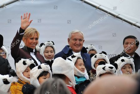 French President wife's Brigitte Trogneux, former senator Jean-Pierre Raffarin and China's Vice Foreign Minister Zhang Yesui wave after the panda cub's name ceremony.
