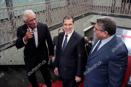 Morocco's Prime Minister Saad-Eddine El Othmani, center, welcomes his Portuguese counterpart Antonio Costa, left, during an official visit to Rabat, Morocco