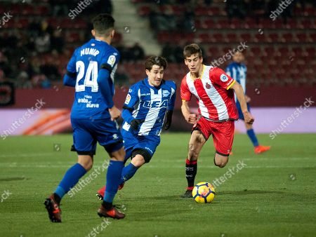 Alaves' forward Bojan Krkic (C) in action against Pere Pons (R) of Girona during thier Spanish Primera Division soccer match played at Montilivi stadium in Girona, Catalonia, 04 December 2017.