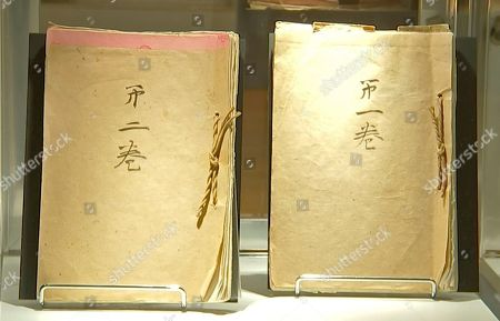 In this image from an Associated Press video, post-World War II memoirs composed by Japanese Emperor Hirohito are displayed at Bonham's, in New York. The two-volume, 173 page document, was dictated by the emperor to several aides after the war and transcribed word-for-word by a senior diplomat. It was created at the request of Gen. Douglas MacArthur, whose administration controlled Japan at the time. The memoir, also known as the imperial monologue, covers events from the Japanese assassination of Manchurian warlord Zhang Zuolin in 1928 to the emperor's surrender broadcast recorded on Aug. 14, 1945. It is expected to fetch between $100,000 and $150,000 at Bonhams' auction Dec. 6