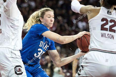 Erin Matthews, A'ja Wilson. Duke center Erin Mathias (35) passes around South Carolina forward A'ja Wilson (22) during the second half of an NCAA college basketball game, in Columbia, S.C. South Carolina defeated Duke 72-52