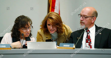 Wendy Vogel, Anne Marie Lemieux, David Ray. From left, directors of the Douglas County School Board Wendy Vogel, Anne-Marie Lemieux and David Ray confer before a meeting, in Castle Rock, Colo. A new anti-voucher majority on the board was set to eliminate a program enacted by an earlier conservative-dominated board to help public school students attend secular and religious schools with taxpayer-funded vouchers