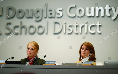 Krista Holtzmann, Anne Marie Lemieux. Krista Holtzmann, left, and Anne-Marie Lemieux, directors on the Douglas County School Board, listen to speakers during a meeting, in Castle Rock, Colo. A new anti-voucher majority on the board was set to eliminate a program enacted by an earlier conservative-dominated board to help public school students attend secular and religious schools with taxpayer-funded vouchers