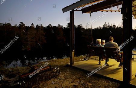 Elton Connor, Bruce Kinlaw, Ricky Phillips. Elton Connor, rear, joins Bruce Kinlaw and Ricky Phillips on the patio before dinner is ready at their weekly gathering at a home in Lumberton, N.C., . Sometimes, the men watch Fox News and talk politics. These days, they turn on football and bemoan the national anthem protests that, to them, represent an unraveling of American values of tradition, patriotism and honor