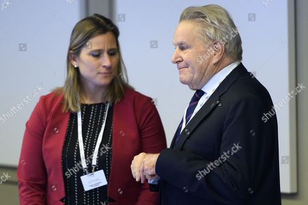 International Olympic Committee (IOC) members Denis Oswald (R) of Switzerland speaks with Angela Ruggiero (C) from the United States, next to Gian-Franco Kasper (L) from Switzerland, prior to the opening of the first day of the executive board meeting of the International Olympic Committee (IOC) at the IOC headquarters, in Pully near Lausanne,  Switzerland, 05 December 2017.