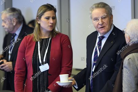 Stock Image of International Olympic Committee (IOC) members Denis Oswald (R) of Switzerland speaks with Angela Ruggiero (C) from the United States, next to Gian-Franco Kasper (L) from Switzerland, prior to the opening of the first day of the executive board meeting of the International Olympic Committee (IOC) at the IOC headquarters, in Pully near Lausanne,  Switzerland, 05 December 2017.