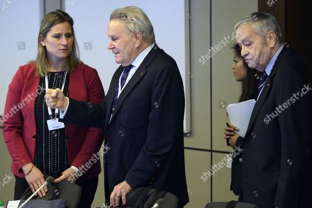 International Olympic Committee (IOC) members Denis Oswald (C) of Switzerland speaks with Angela Ruggiero (L) from the United States, next to Gian-Franco Kasper (R) from Switzerland, prior to the opening of the first day of the executive board meeting of the International Olympic Committee (IOC) at the IOC headquarters, in Pully near Lausanne, Switzerland, 05 December 2017.